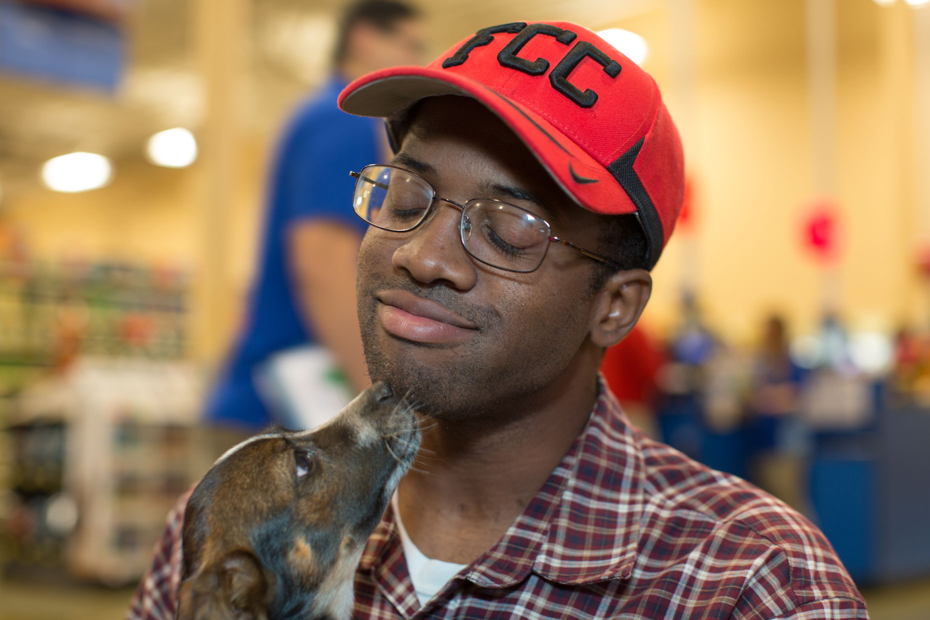 Marketing Photography | Man Getting Dog Kiss by Mark Rogers