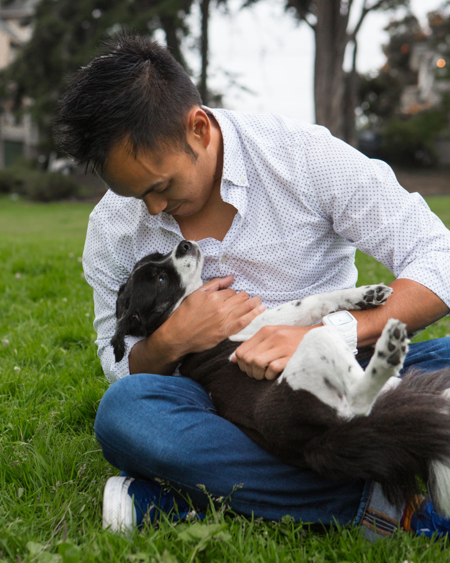 Commercial Photography | Asian Man Holding Dog by Mark Rogers