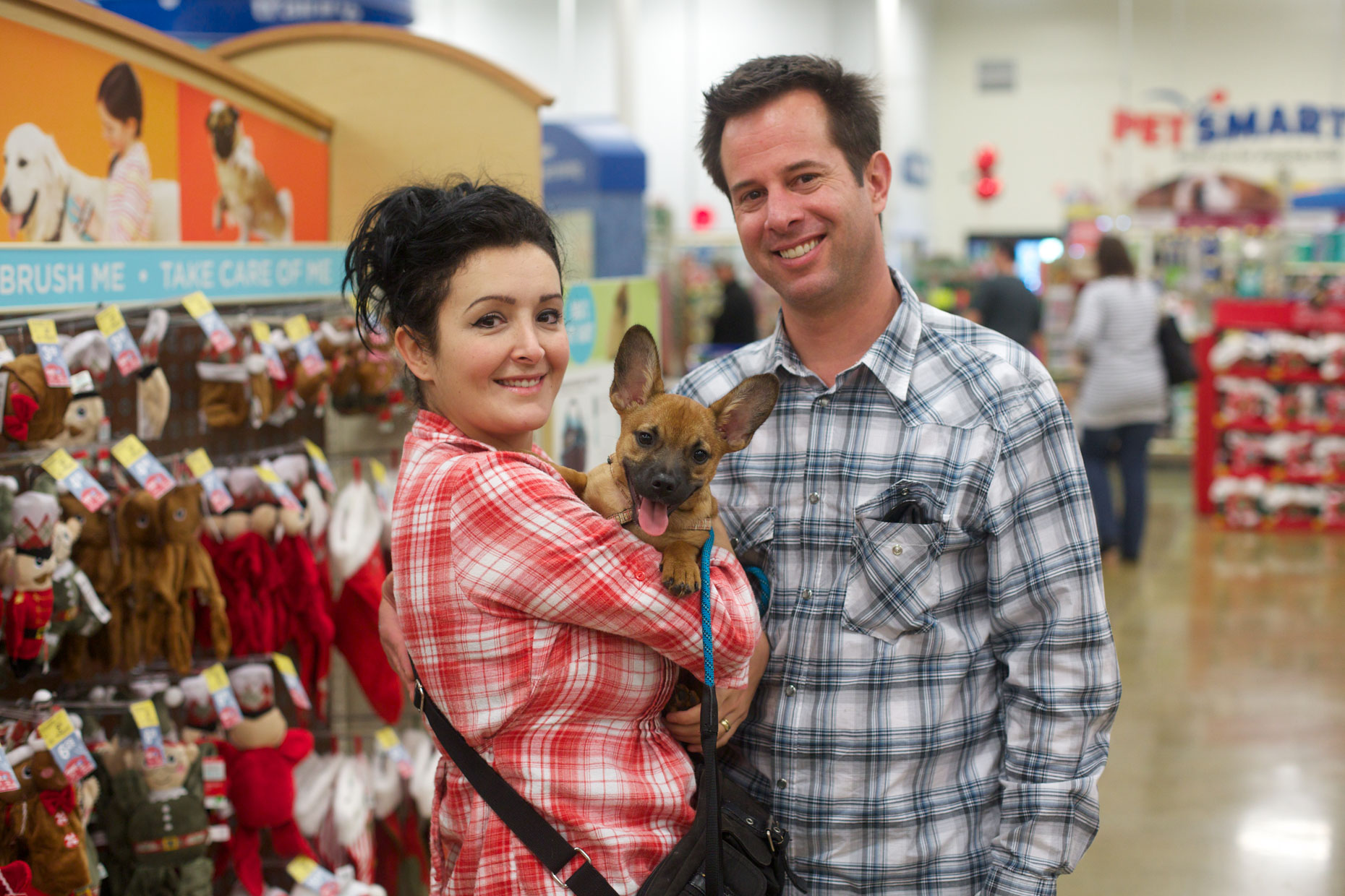 Advertising Photography | Couple Holding Dog in PetSmart by Mark Rogers