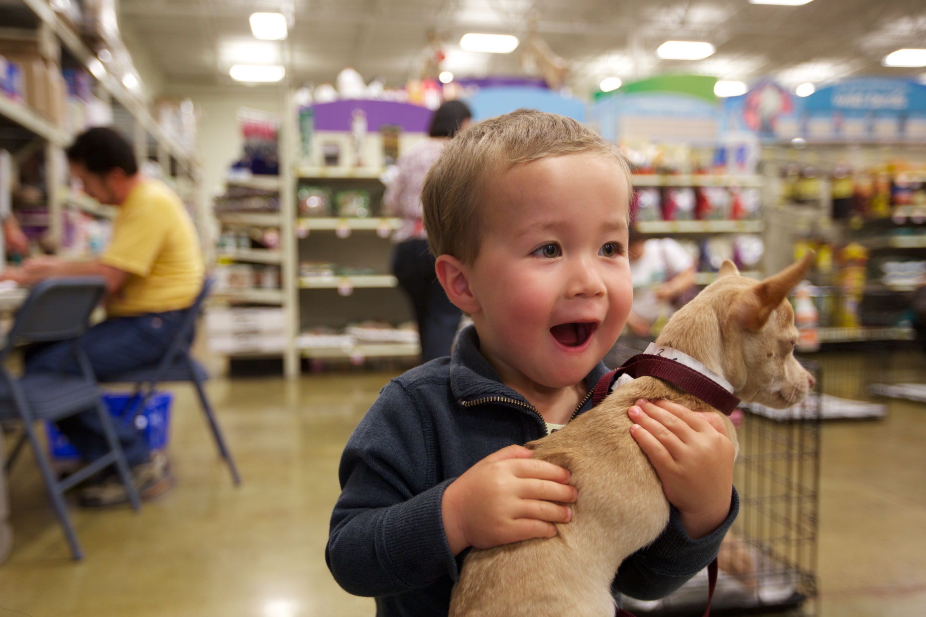 Advertising Photography | Excited Boy Holding Dog by Mark Rogers