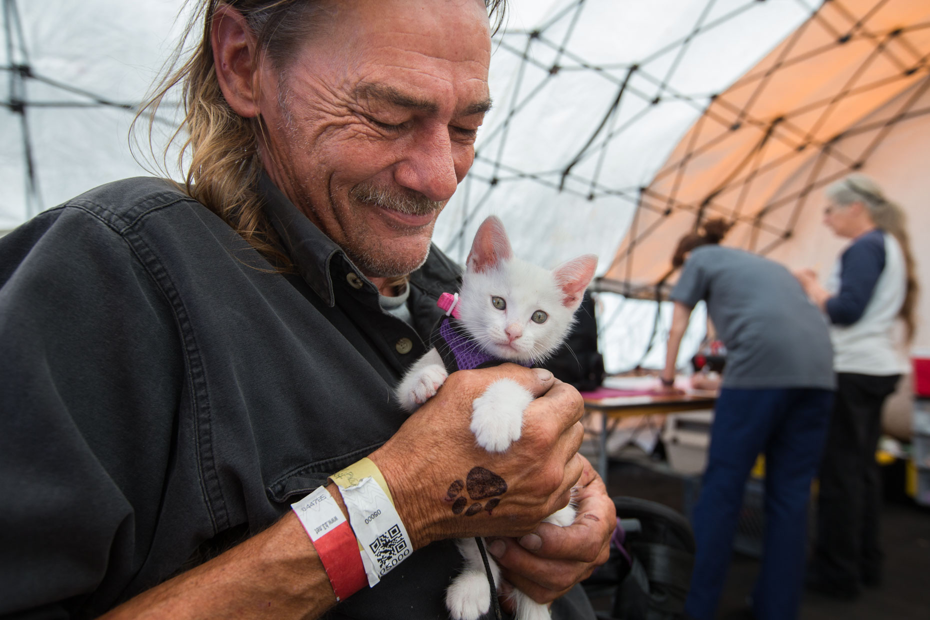 Editorial Photography | Homeless Man Holding Kitten by Mark Rogers