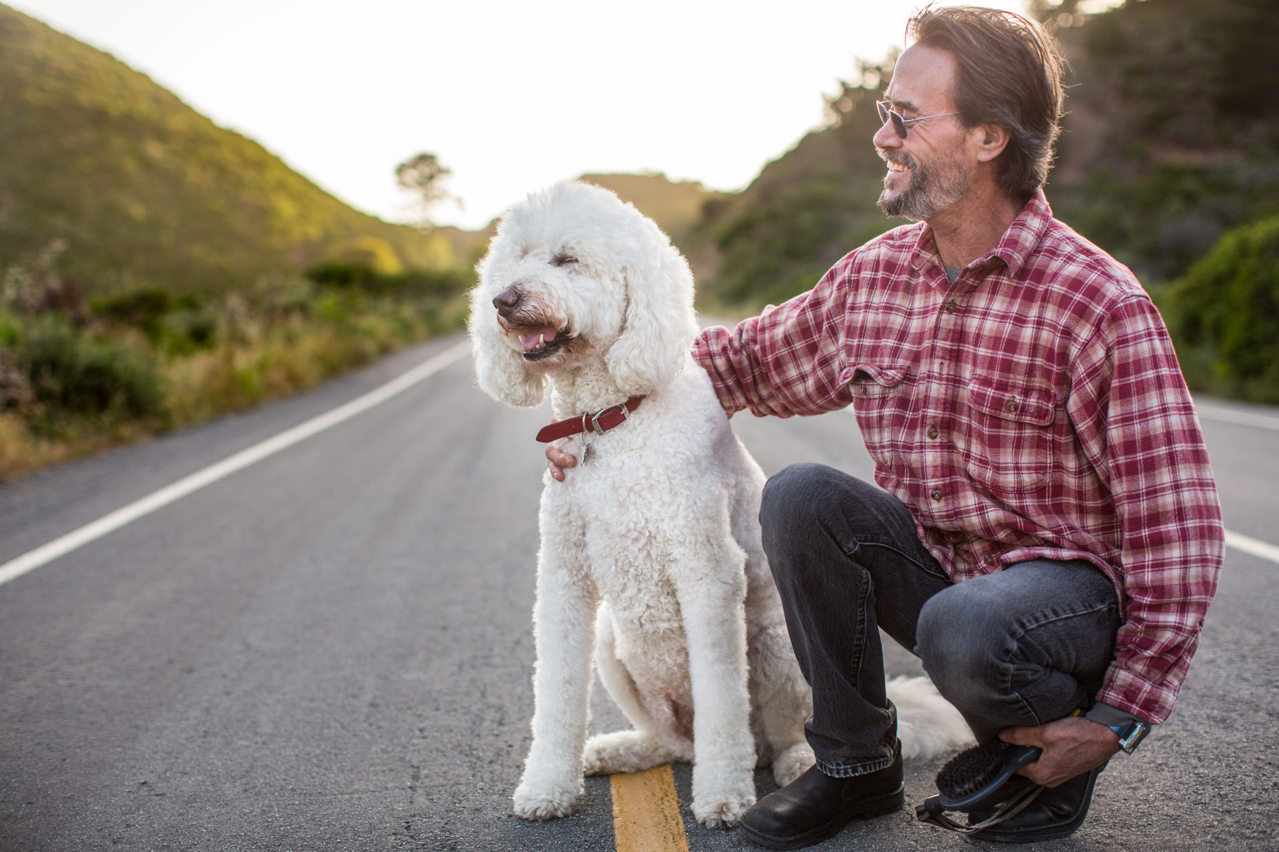 Commercial Photography | Man Laughing with Poodle by Mark Rogers