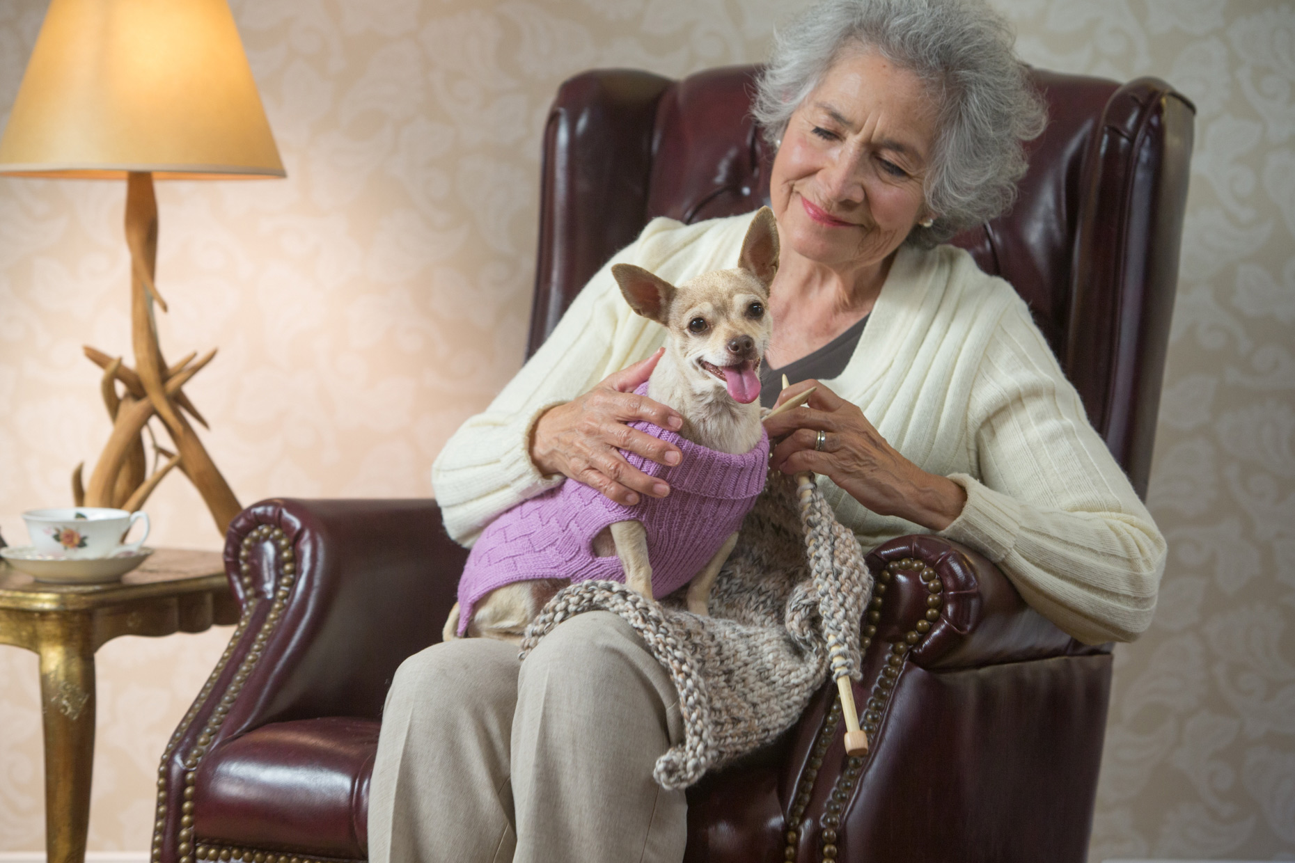 Commercial Lifestyle Photography | Senior woman knitting with dog