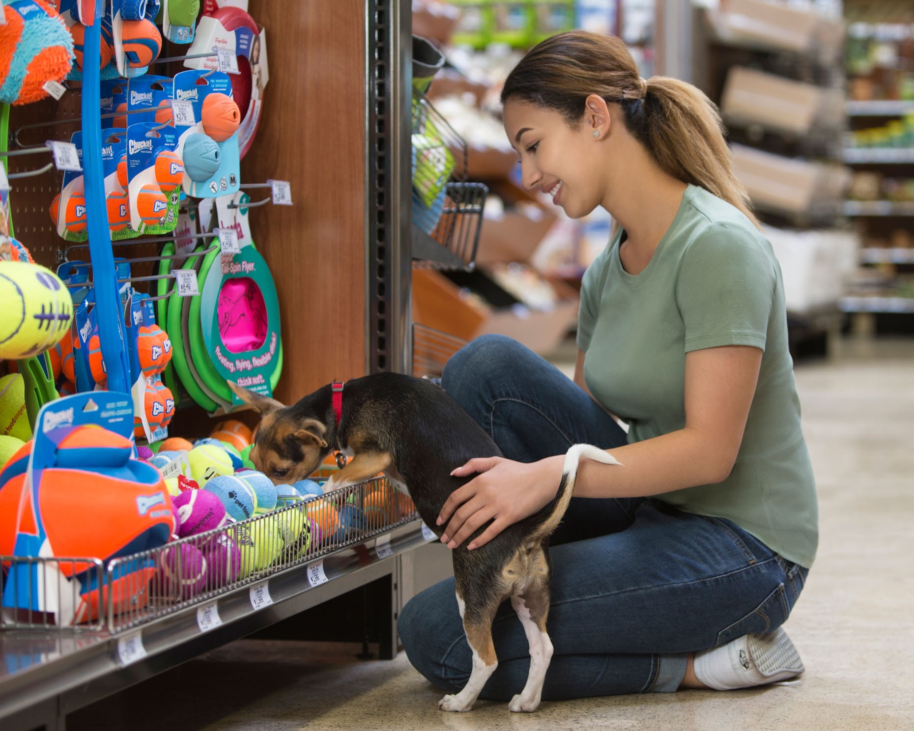Pet Lifestyle Photography | Woman Toy Shopping with Dog by Mark Rogers