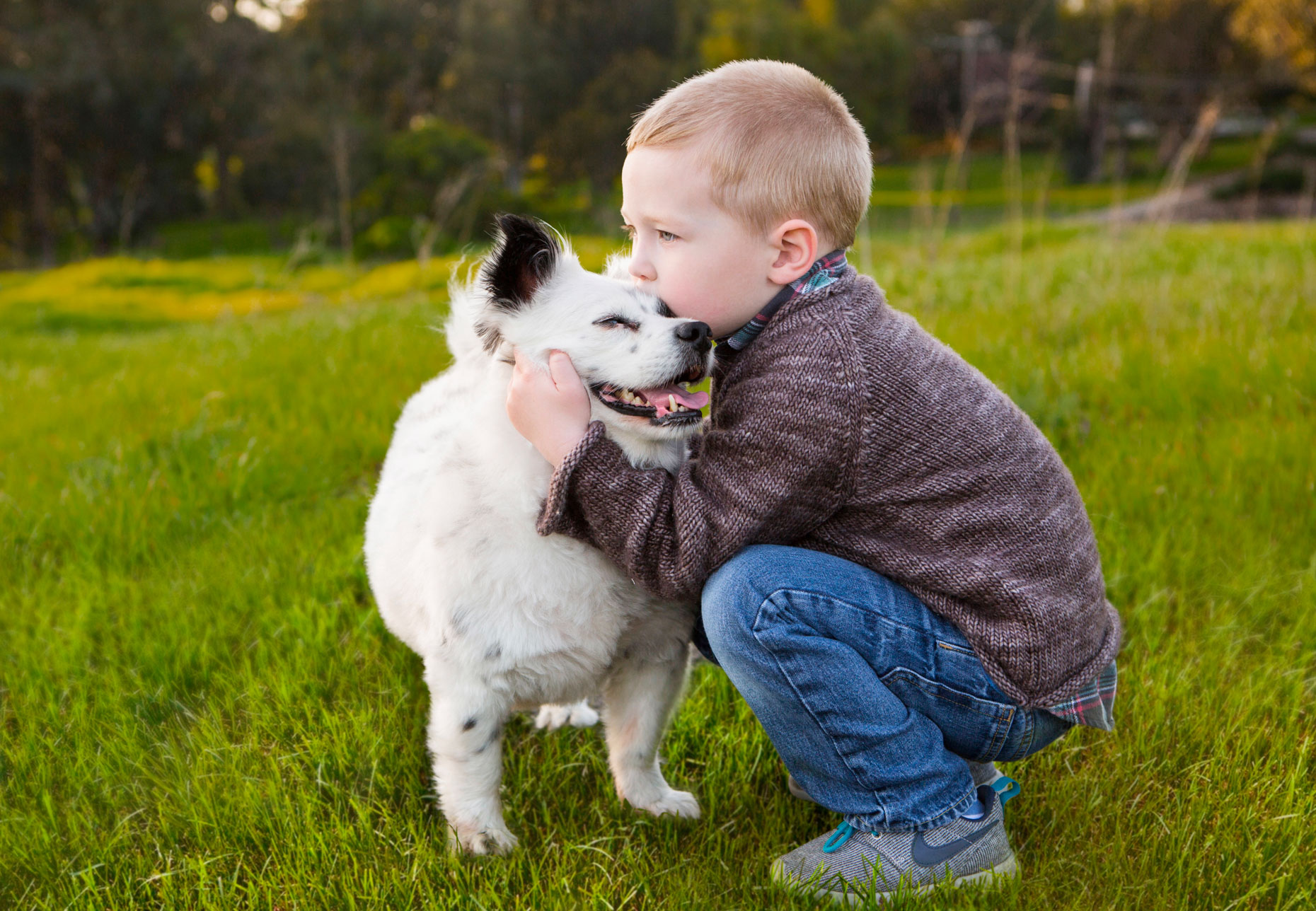 Dog and People Photography | Boy Kissing Dog by Mark Rogers